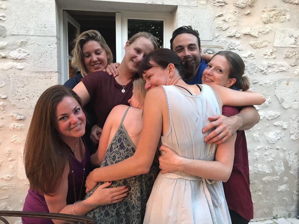Yogi team hug